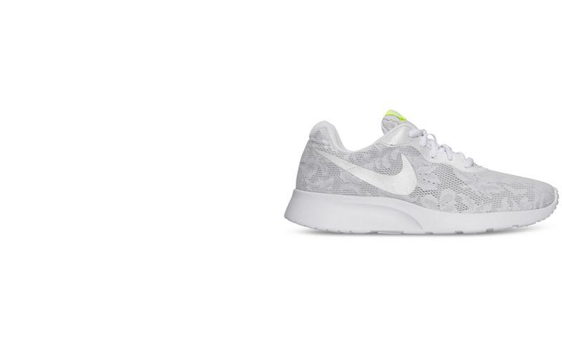 big sale 4b0ce fbf9a ... get nike womens tanjun eng casual sneakers .. 77af7 ea91b