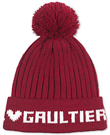 Receive a Complimentary beanie with any large spray purchase from the Jean Paul Gaultier Le Male Fragrance Collection