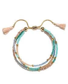 Capwell & Co. Peach Beaded Tassel Bracelet