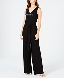 bebe Juniors' Multi-Strap Logo Jumpsuit