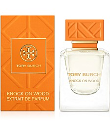 Receive a complimentary Knock on Wood Deluxe Mini with any purchase of $125 or more from the Fragrance Collection