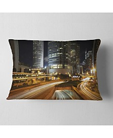 """Designart Skyscrapers and Busy Traffic Cityscape Throw Pillow - 12"""" x 20"""""""