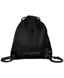 Receive a Complimentary Burberry Sling Backpack with any large spray purchase from the Burberry Men's fragrance collection