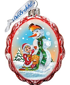 Playing with The Snowman Glass Ornament