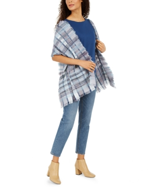 Take classic style with you everywhere with this Cejon wrap in timeless, textured plaid.