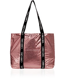 Receive a Free Pink Tote Bag with any large spray purchase from the Carolina Herrera Good Girl collection, A Macy's Exclusive!