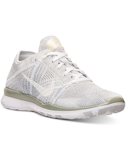 best service 5fd9b 438e9 ... Nike Women s Free 5.0 TR Flyknit Metallic Training Sneakers from Finish  ...