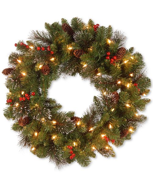 "National Tree Company 24"" Crestwood Spruce Wreath with Silver Bristle, Cones, Red Berries and Glitter with 50 Clear Lights"
