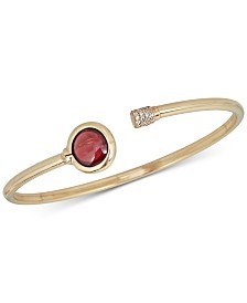 Garnet (2 ct. t.w.) and Diamond (1/5 ct. t.w.) Bangle Bracelet in 14k Gold over Sterling Silver