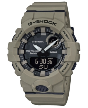 Stay connected and on track with this technologically sophisticated timepiece from G-Shock. This distinctive khaki colored analog-digital device is a precise step tracker with digital data recording and wireless connectivity. Style #GBA800UC-5A
