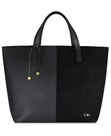 Receive a Complimentary Donna Karan Tote, tassel, and travel deodorant with any $120 or more purchase from the Donna Karan Women's Cashmere Mist fragrance collection