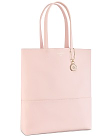 Receive a Complimentary Tote with any large spray purchase from the Azzaro Wanted Girl fragrance collection