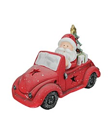 Santa Claus Driving Red Vintage Beetle With a Christmas Tree Table Top Decoration