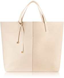 Receive a Complimentary Donna Karan Tote with any $120 purchase from the Donna Karan Cashmere Mist Fragrance Collection