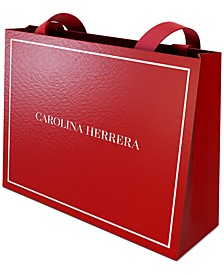 Receive a Free Gift Bag with any large spray purchase from the Carolina Herrera Fragrance Collection