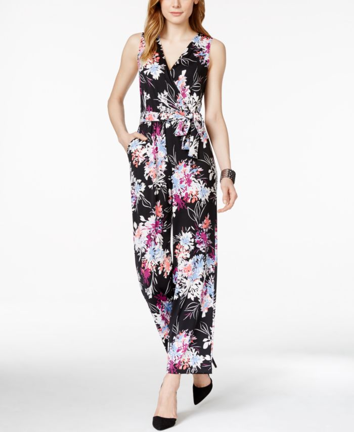 petite model wearing floral jumpsuit