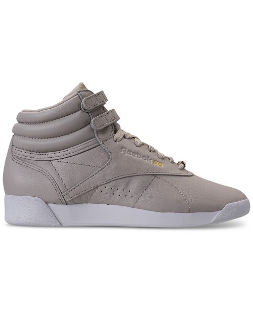 163784f19411 ... Reebok Women s Freestyle Hi Top Muted Casual Sneakers from Finish ...