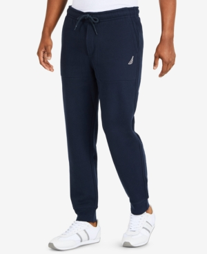 Comfortable enough for errands or a run to the gym, these Nautica jogger pants have elastic cuffs at the hem and a classic fit for the most modern way to kick back.