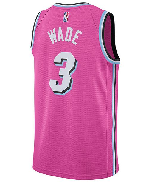 3d9080a8fe28 ... Nike Men s Dwyane Wade Miami Heat Earned Edition Swingman Jersey ...