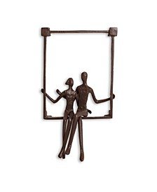 Couple Sitting on a Window Seal Iron Wall Piece