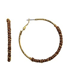 by 1928 14 K Gold Dipped Clutch Wrapped Hoop Earring