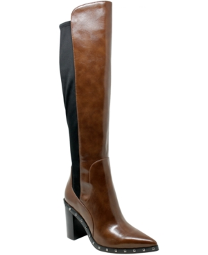 Step up your style game with this sleek boot fashioned with studs and stretch backing. It features a regular calf.