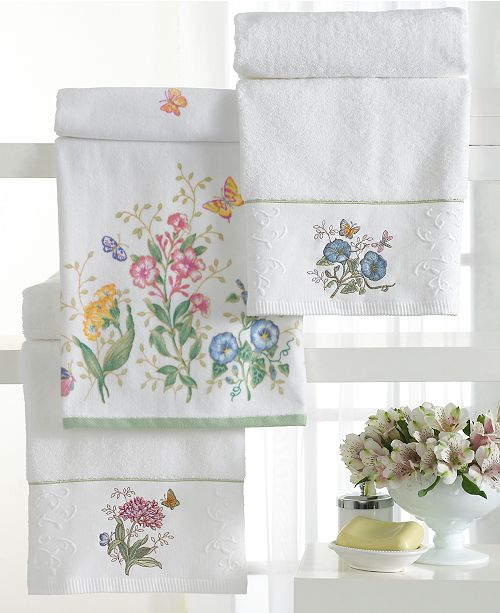 Refresh In The Whimsical Wonder Of Butterfly Meadow Bath Accessories Butterflies And Vibrant Flowers Dance Against A White Ground This Pattern