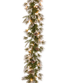 National Tree Company 9' Feel Real® Liberty Pine Garland With Pine Cones, Snow & 50 Clear Lights