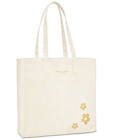 Receive a Complimentary Tote with any large spray purchase from the MARC JACOBS Daisy fragrance collection