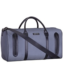 Receive a Complimentary Duffel with any large spray purchase from the Kenneth Cole Men's fragrance collection