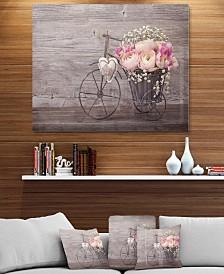 """Designart 'Ranunculus Flowers In Bicycle Vase' Floral Metal Wall Art - 40"""" X 30"""""""