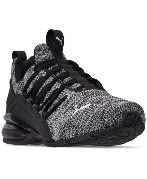 PUMA Mens Axelion Sneaker, Black White