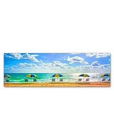 "Preston 'Florida Beach Chairs Umbrellas' Canvas Art - 10"" x 32"""