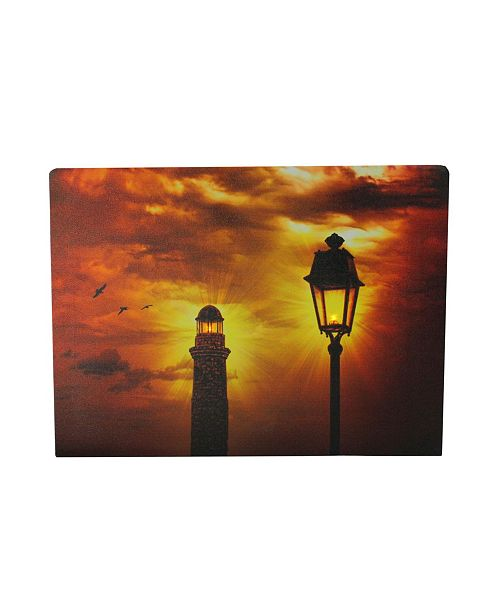"Northlight LED Lighted Lighthouse and Lantern Lamp Post with Amber Sky Canvas Wall Art, 11.75"" x 15.75"""