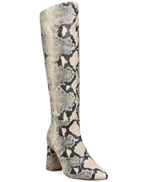 Dress up skinny jeans and tailored skirts with a striking profile in the block heel lift of Madden Girl\\\'s Fireflyy dress boots.