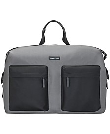 Receive a Complimentary Duffel Bag with any large spray purchase from the Kenneth Cole Men's Fragrance Collection