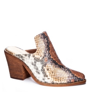 Casual western style pointed toe mule with studded trim detailing and stacked block heel.