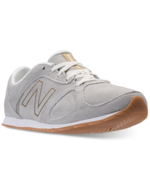 New Balance 555 Sneaker in Cream/ Gold