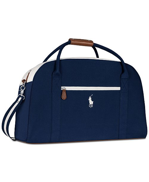 49e4f821e50 Receive a Complimentary Duffel Bag with any large spray purchase from the Ralph  Lauren Polo Blue fragrance collection