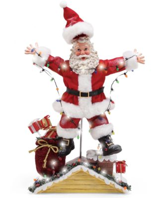 Possible Dreams Santa Hanging Lights on Roof Figurine