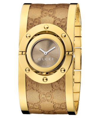 Image of Gucci Women's Swiss Twirl Yellow Gold Plated Stainless Steel and Guccisima Leather Bangle Bracelet W