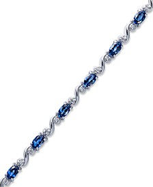 Sterling Silver Bracelet, Oval-Cut Tanzanite (3 ct. t.w.) and Diamond (1/8 ct. t.w.) Bracelet