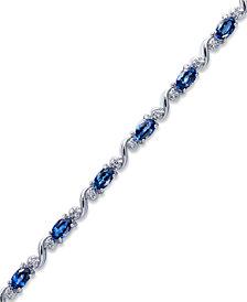 Sterling Silver Bracelet, Oval-Cut Tanzanite (3 ct. t.w.) and Diamond (1/8 ct. t.w.) Bracelet