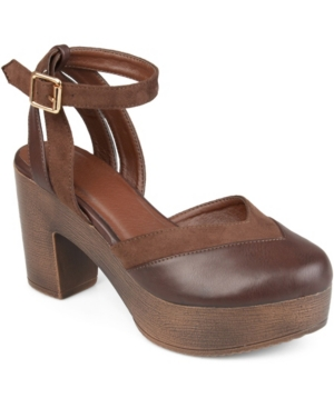 These platform shoes by Journee Collection have faux leather and faux suede material with a sweetheart cut above the toes. Chunky faux woodgrain heels and thick platforms add bold height to the look and ankle straps wrap around each ankle.