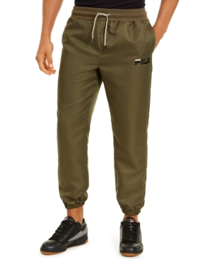 Be prepared for a lot of compliments every time you toss on these eye-catching Jupiter jogging pants from Fila, complete with elastic drawstring waist and woven twill construction.