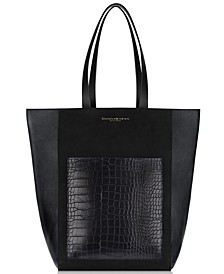 Receive a Complimentary Donna Karan Tote with any $122 purchase from the Donna Karan Cashmere Mist Fragrance Collection