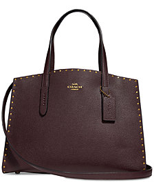 COACH Border Rivets Charlie Carryall in Pebble Leather
