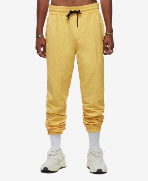 The Yellow Track Pant is the perfect pick for your laidback style vibe, day or night. This nylon mesh-lined men\'s track pant features a comfortable elasticized drawcord waistband, hip zip pockets with reflective detailing, and back welt pockets. Finished with an elasticized tapered ankle hem.