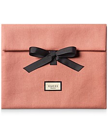 Receive a Complimentary Pouch with any large spray purchase from the Gucci Bloom fragrance collection