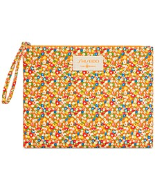 Get a FREE Shiseido x Tory Burch Pouch with your purchase of Tory Burch Ultimate Sun Protector Lotion SPF 50+ Sunscreen